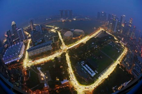 The Marina Bay street circuit is illuminated at dusk after a downpour in Singapore September 11, 2014. The Singapore Formula One Grand Prix night race will take place on September 21, 2014. Picture taken with a fish-eye lens. REUTERS/Edgar Su