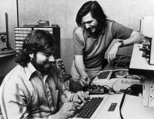 Steve Wozniak (seated) with Steve Jobs