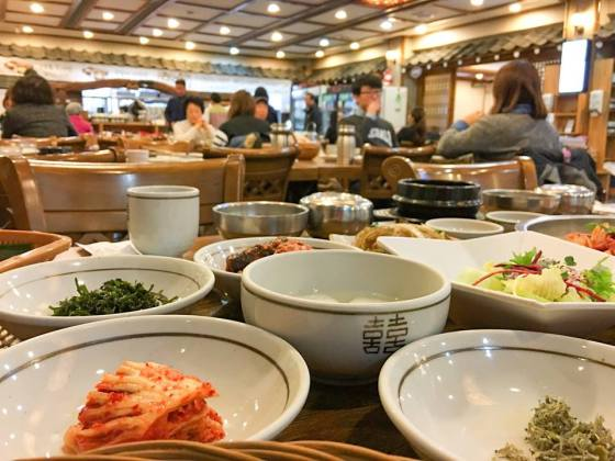 PM's caption: Where all the ingredients come together. All the bowls on the table are side dishes, including of course kimchi. The main course was bulgogi, a stew of marinated beef.