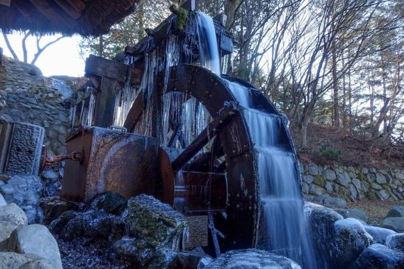 "PM's caption: ""A waterwheel all frozen up, though some water is still flowing over it."""