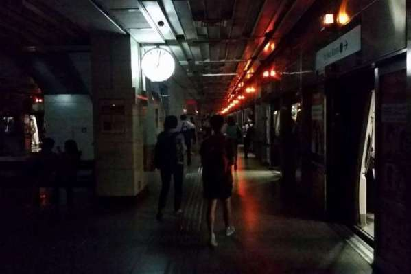 People walking in the dark at Tiong Bahru MRT on April 25, 2016. PHOTO: MATTHEW CHAN
