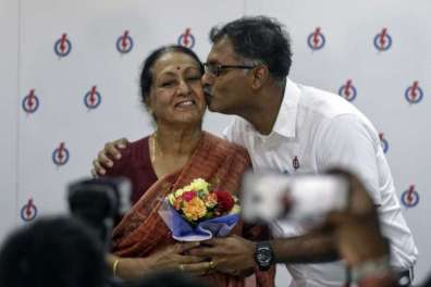 Mr Murali celebrating his win with his mother. Image from Straits Times