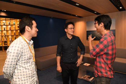 Isaac, VP of Talent, and Jonathan, VP of Engineering talking to Desmond. Photo from Young NTUC